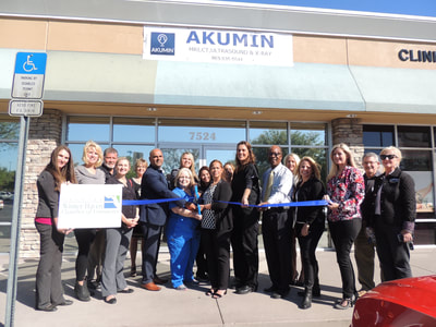 Akumin ribbon cutting
