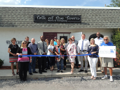 Talk of the town nails ribbon cutting
