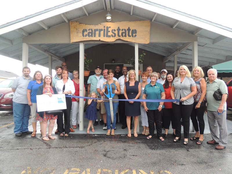 CarriEstate ribbon cutting