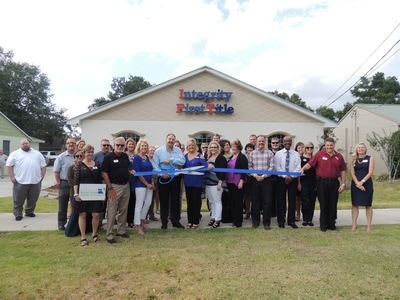 Integrity First Title ribbon cutting