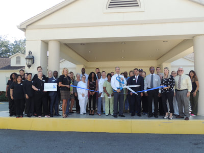 Palm Garden ribbon cutting