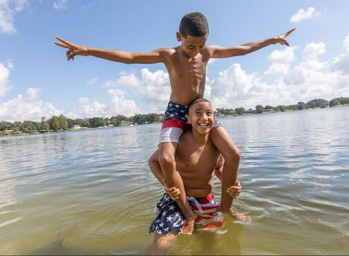 Picture of two boys playing in the lake